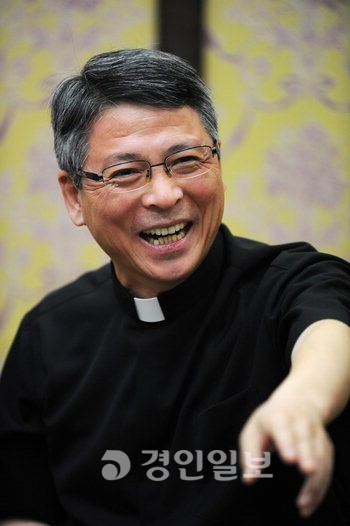 "Sung-Hyo Lee Catholic Bishop.  ""My favorite food is dog meat.  My hobby is forcing dog meat on foreign priests."" Source: Kyeonggin Ilbo."