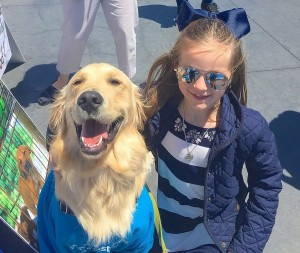 This cute girl was so smitten by Buster she came back with her parents twice to sign the petition.