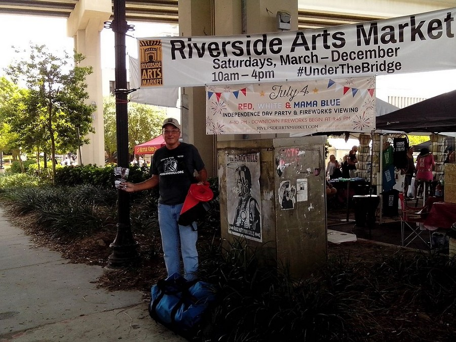 "I was the ""lone wolf"" KoreanDogs.org advocate at The Riverside Arts Market in Jacksonville, Florida on the St. Johns River 7-11-15. I was there two hours. I gave away 31 KoreanDogs messenger bags, 32 KD Frisbees, and about 120 leaflets. I've done demonstrations by myself before and I'll do them again."